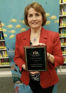 Kadie Mazzi with FL Library Association award, 2015