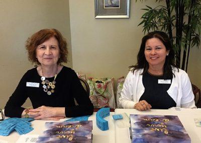 Linda Busler and Minerva King sell raffle tickets
