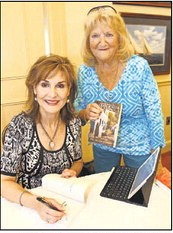 Karen White signs her book for Connie Jackson