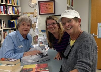 Bookstore Volunteer and patrons at the Punta Gorda Library