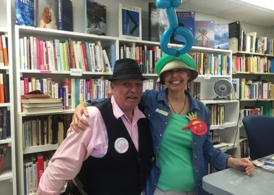 Joe the Balloon Dude and Lisa wearing one of his creations in the Bookstore