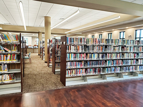 Several Rows of Book Shelves filled with books at the Punta Gorda Charlotte Library