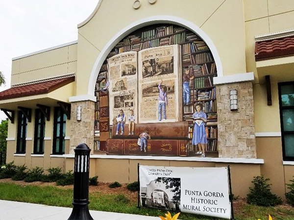 Mural celebrates the 112-year history of a library in Punta Gorda.